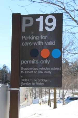 Parking Sign showing black and orange dots