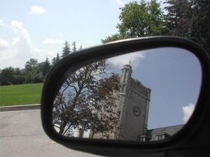 Picture of Johnston Hall in reflection of side view mirror